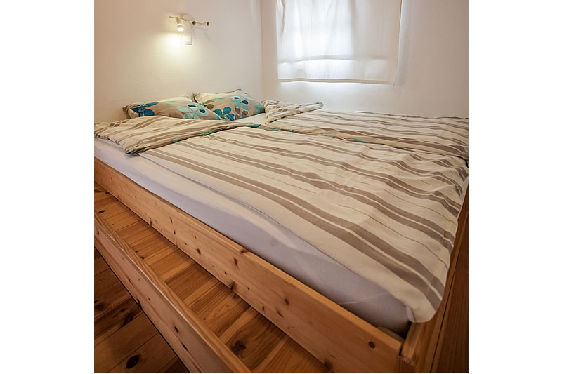 double bed with 180 x 200 cm in the bedroom