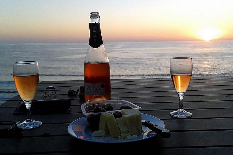 Enjoying an aperitiv on the Dream View House terrace at sunset